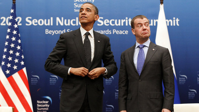 U.S. President Barack Obama, left, and Russian President Dmitry Medvedev stand together at the end of a bilateral meeting at the Nuclear Security Summit in Seoul, South Korea, March 26, 2012. (Photo by Pablo Martinez Monsivais/AP Photo)