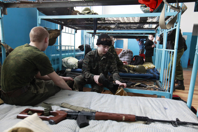 Students from the Yermolov Cadet School lodge at a training base, the terminal point of their training march, near the southern Russian city of Stavropol March 29, 2012. (Photo by Eduard Korniyenko/Reuters)
