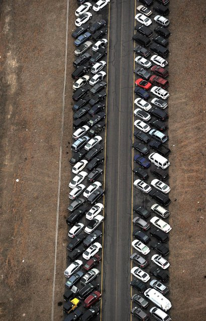 Tens of thousands of vehicles damaged by super storm Sandy are being temporarily stored on runways and taxiways at Calverton Executive Airpark in Calverton, New York, on January 9, 2013 in this aerial view. Insurance Auto Auctions Inc, a salvage auto auction company specializing in total-loss vehicles, acquired the cars and trucks that were damaged, destroyed or flooded by the storm and needed a place to store them. The company made a deal with the Town of Riverhead to lease the airport land and then the vehicles are auctioned online. AFP PHOTO/Stan HONDASTAN HONDA/AFP/Getty Images