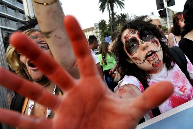 "The 7th Zombie Walk takes place in Nice at ""Promenade des Anglais"" on October 26, 2014. (Photo by Bebert Bruno/SIPA Press)"