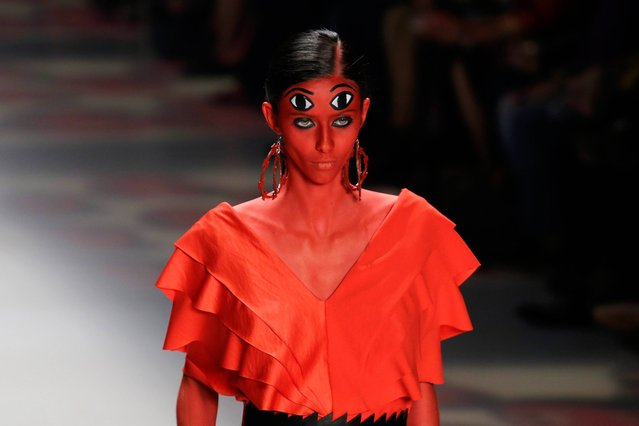 A model wears a creation from the Ronaldo Fraga Winter collection during the Sao Paulo Fashion Week in Sao Paulo, Brazil, Wednesday, November 5, 2014. (Photo by Nelson Antoine/AP Photo)