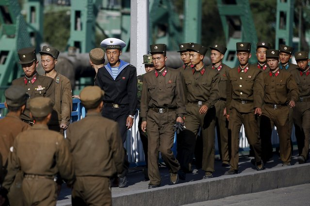 Military personnel cross a bridge in central Pyongyang, North Korea early October 9, 2015. (Photo by Damir Sagolj/Reuters)