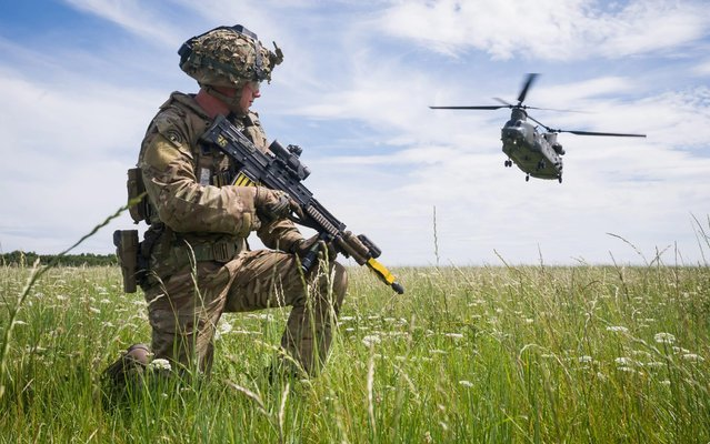 Private Patrick Rodgers of the Royal Anglian Regiment, 2nd Battalion maintains the perimeter as a Chinook helicopter arrives for a medical evacuation during a military exercise on Salisbury Plains on July 23, 2020 near Warminster, England. (Photo by Leon Neal/Getty Images)
