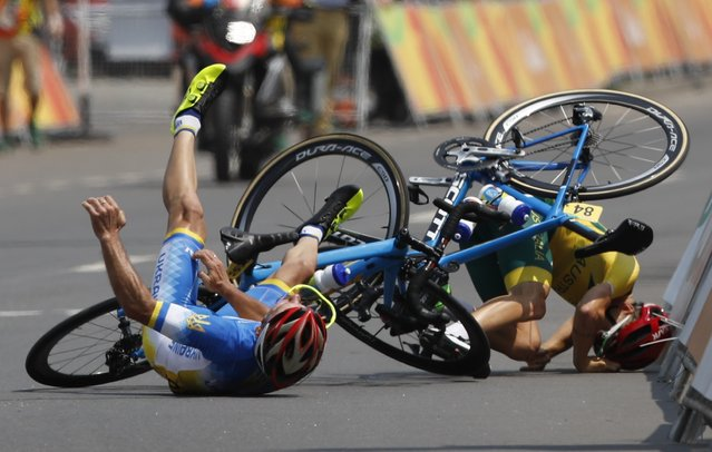 2016 Rio Paralympics, Cycling Road, Men's Road Race C4-5, Rio de Janeiro, Brazil on September 17, 2016.  Yehor Dementyev of Ukraine and Alistair Donohoe of Australia crash on the last meters of the race. (Photo by Carlos Garcia Rawlins/Reuters)