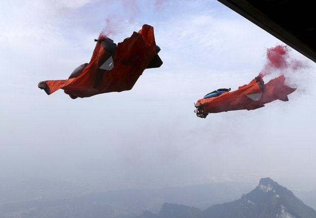 Wingsuit flyer contestants jump off a mountain during the fourth World Wingsuit Flying Tournamentat at the Tianmen Mountain National Park in Zhangjiajie, Hunan province, China, October 18, 2015. (Photo by Reuters/China Daily)