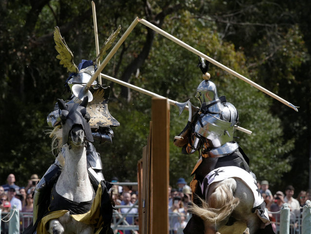 Jousters Arne Koets from the Netherlands (L) and Australia's Cliff Marisma both break their lances during the jousting tournament at the St Ives Medieval Fair in Sydney, one of the largest of its kind in Australia, September 24, 2016. (Photo by Jason Reed/Reuters)