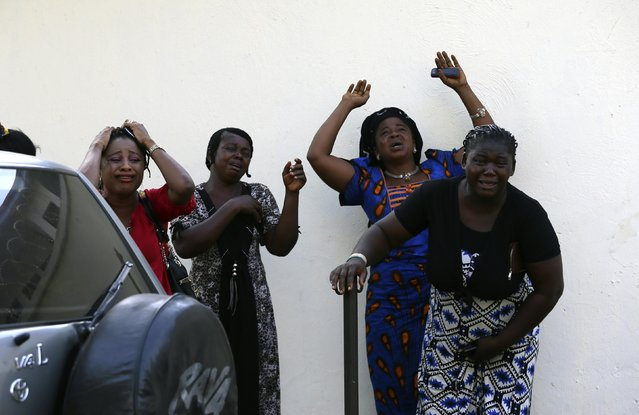 Bystanders react as victims of a bomb blast arrive at the Asokoro General Hospital in Abuja in this April 14, 2014 file photo. A morning rush-hour bomb killed at least 71 people at a Nigerian bus station near the capital. I had just shot the wedding of the president's daughter in Abuja and was looking forward to a quiet week. On my way home I was listening to the radio and then came the announcement of an explosion in the busy Nyanya suburb. (Photo and caption by Afolabi Sotunde/Reuters)