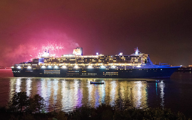 Cruis liner Queen Mary 2 passes under fireworks during her visit to Hamburg, Germany, 20 October 2015. The prestigious luxury liner visits Hamburg for the 50th time and continues her journey to New York. (Photo by Daniel Bockwoldt/EPA)