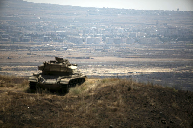 The Syrian area of Quneitra is seen in the background as an out-of-commission Israeli tank parks on a hill, near the ceasefire line between Israel and Syria, in the Israeli-occupied Golan Heights, August 21, 2015. (Photo by Baz Ratner/Reuters)