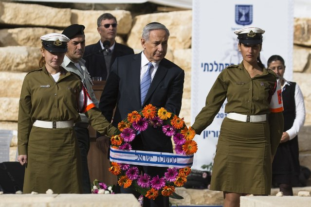 Israel's Prime Minister Benjamin Netanyahu attends the annual memorial ceremony for Israel's first prime minister, David Ben-Gurion, in Sde Boker, southern Israel November 27, 2014. (Photo by Amir Cohen/Reuters)