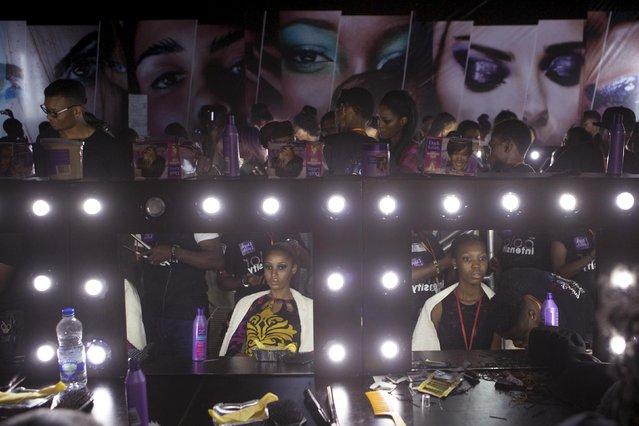 Make-up artists work on models backstage at Lagos Fashion and Design Week in Lagos, Nigeria, October 29, 2015. (Photo by Joe Penney/Reuters)