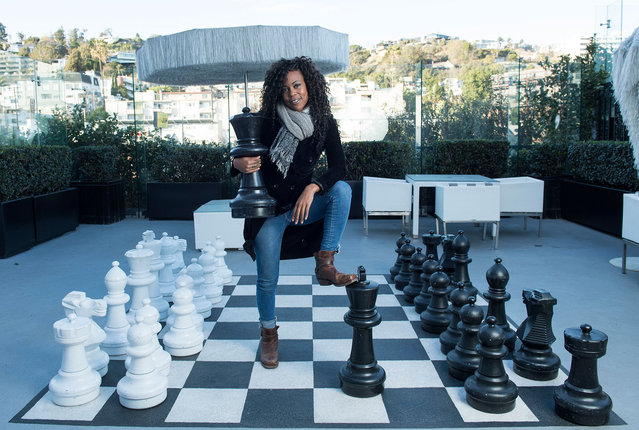 """Hannah Beachler, production designer, poses for a picture in West Hollywood, California, on February 22, 2018. Hannah Beachler has designed Wakanda, the """"Black Panther"""" fictional African home and world. Hannah is the only black woman at the top of her field. (Photo by Valerie Macon/AFP Photo)"""