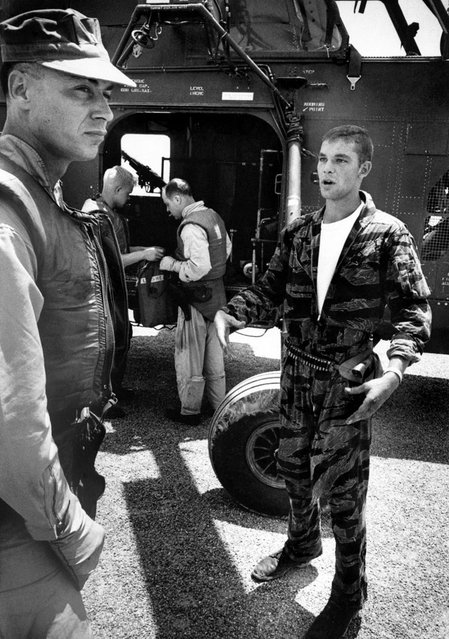 "Farley talks to his own pilot, Captain Vogel, about the pilot who had to be left behind in YP3. ""If we had stayed another 10 seconds under those V.C. machine guns"", Vogel said, ""you or us would never have got out of there"". (Photo by Larry Burrows/Time & Life Pictures)"