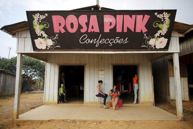 Women talk outside a clothing boutique in Rio Pardo next to Bom Futuro National Forest, in the district of Porto Velho, Rondonia State, Brazil, August 29, 2015. (Photo by Nacho Doce/Reuters)
