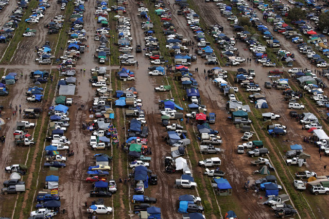 Campers trudge through mud among hundreds of ute vehicles in a paddock in this aerial picture at the Deni Ute Muster in Deniliquin, New South Wales, Australia, October 1, 2016. (Photo by Jason Reed/Reuters)
