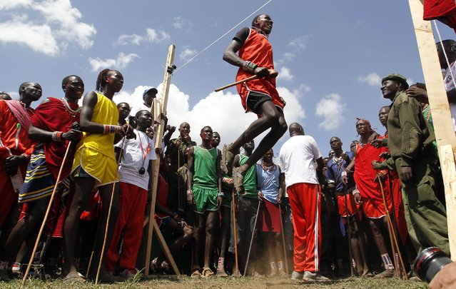 A Maasai moran competes in their traditional high-jump event during the Maasai Olympics 2014 at the Sidai Oleng wildlife sanctuary at the base of Mt. Kilimanjaro near the Kenya-Tanzania border in Kajiado December 13, 2014. Scores of young Maasais representing four manyattas – a barrack for warriors aged about 16-25 – competed against each other on Saturday for prestige, bragging rights and a prized breeding bull for their manyatta. (Photo by Thomas Mukoya/Reuters)