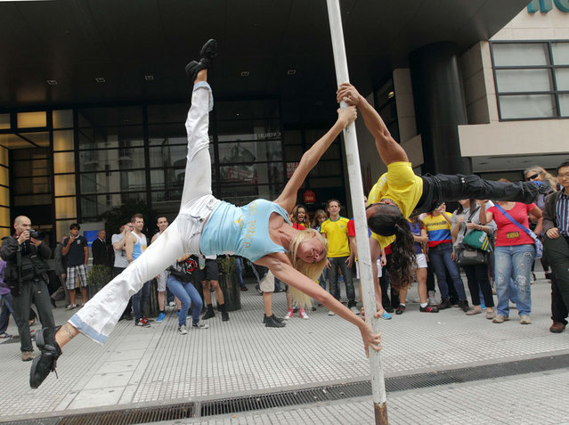 Daniela Schmoll, of Argentina (L), performs a pole dancing routine to promote the Miss Pole Dance South America 2012 competition in Buenos Aires November 23, 2012. (Photo by Enrique Marcarian/Reuters)