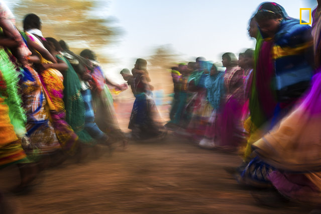 """""""Local festivals are the best time to understand the vibrant tribal culture. The Ghotpal Mandai in the Dantewada region of India is dedicated to the local deity. The local deities of all the neighboring villages gather for the Ghotpal mela. The main attractions are the colorful display of culture through the Bison-Horn Madiya dance. Movements to the rhythm of tribal instruments evoke the soul of wanderlust"""". (Photo by Willy Sanson/National Geographic Travel Photographer of the Year Contest)"""