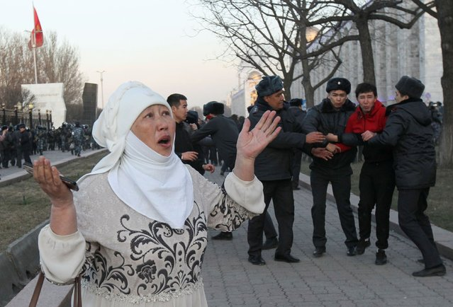 A woman reacts as Kazakh law enforcement officers detain a man during a rally of jailed politician Sadyr Zhaparov's supporters in central Bishkek, Kyrgyzstan on March 2, 2020. (Photo by Vladimir Pirogov/Reuters)