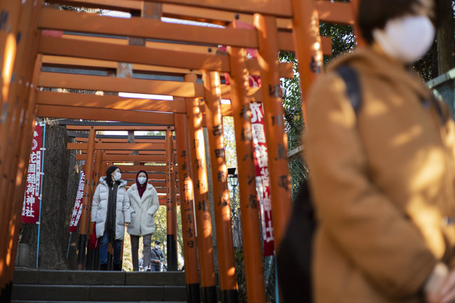 Worshippers visit shrines situated side by side in Tokyo on New Year's Day, Friday, January 1, 2021. (Photo by Hiro Komae/AP Photo)