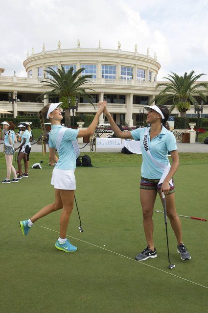 Diana Harkusha, Miss Ukraine 2014 and Queen Celestine (R), Miss Nigeria 2014 take part in a putting contest at the 63rd annual Miss Universe Pageant in Miami, Florida in this January 12, 2015 handout photo provided by Miss Universe Organization. (Photo by Reuters/Miss Universe Organization)