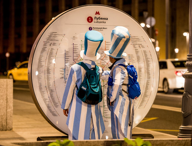Argentina fans look at a metro map for directions in downtown Moscow on June 14, 2018, ahead of the Russia 2018 World Cup football tournament. (Photo by Mladen Antonov/AFP Photo)