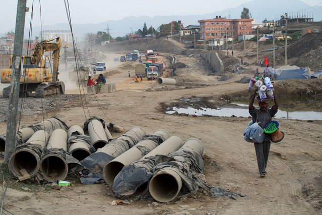 In 2011 Nepal's then prime minister, Baburam Bhattarai, launched a road expansion programme in the capital, Kathmandu. Seven years later, the controversial project is still running. Opponents argue it has increased air pollution, damaged cultural heritage sites and caused major congestion. Supporters say the new roads – especially the expansion of the city's ring road – are vital for the country's development. (Photo by Pete Pattisson/The Guardian)