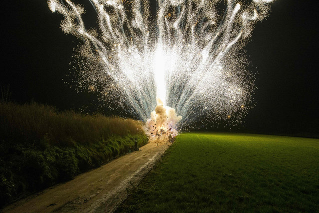 A photograph taken on November 28, 2020 shows a colorful explosion pictured as fireworks store Vuurwinkel destroys it's stock, in Marke, Kortrijk. Due to the ongoing coronavirus pandemic, the sales and use of fireworks has been forbidden. (Photo by Nicolas Maeterlinck/BELGA/AFP Photo)