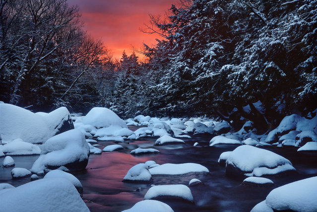 """""""Snowy River Sunrise"""". I had scouted this scene previously. I knew a recent January thaw had cleared the stream, and fresh snow had fallen overnight. I hiked by headlamp in the dark, set up my tripod, and waited in the freezing cold darkness. I was rewarded with this. Location: Bartlett, White Mountains, New Hampshire, USA. (Photo and caption by Dana Clemons/National Geographic Traveler Photo Contest)"""