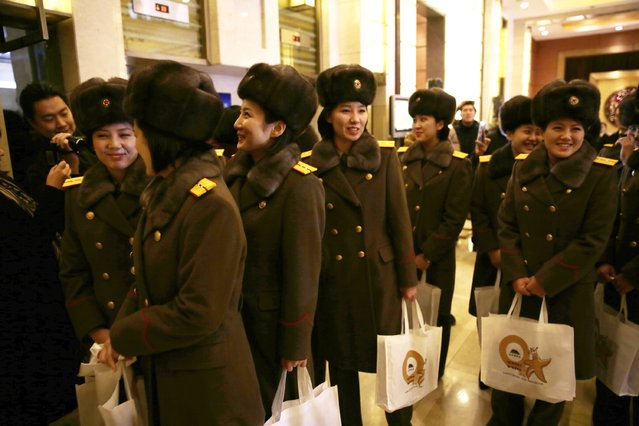 Members of the North Korean female music group Moranbong Band arrive at a hotel after concert rehearsal on December 11, 2015 in Beijing, China. (Photo by ChinaFotoPress/ChinaFotoPress via Getty Images)