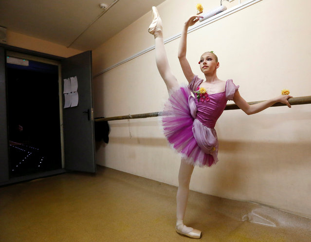 "A contestant prepares backstage before performing at the ""Grand Prix of Siberia"" international ballet competition, held as part of the 4th International Forum ""Ballet. XXI Century"", at the State Opera and Ballet Theatre in Krasnoyarsk, Siberia, Russia, November 11, 2016. (Photo by Ilya Naymushin/Reuters)"