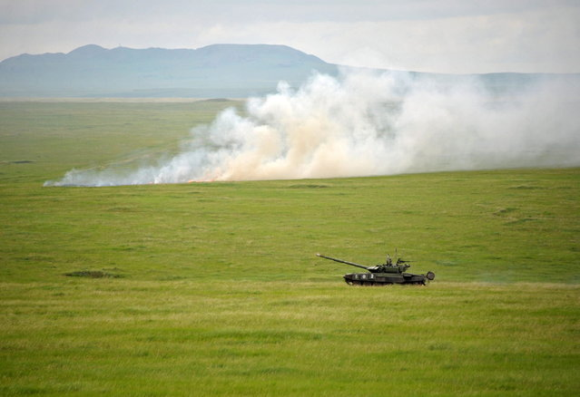 A Russian Army Engenering tank drives near the Baikal Lake in Russia on Wednesday, July 17, 2013. (Photo by Alexei Nikolsky/AP Photo/RIA Novosti/Presidential Press Service)