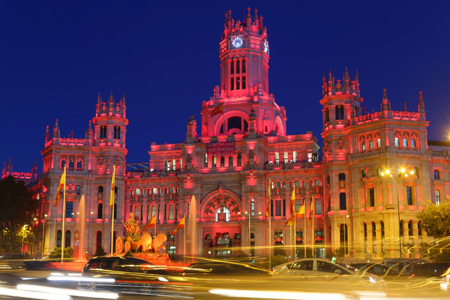 City hall is illuminated pink in recognition of the upcoming U.N. International Day for the Elimination of Violence against Women, in Madrid, Spain, November 21, 2016. (Photo by Paul Hanna/Reuters)