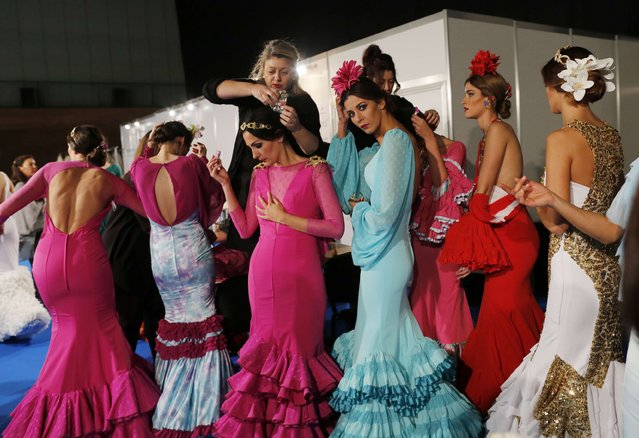 Models wearing creations by Bazarot prepare backstage, during the International Flamenco Fashion Show SIMOF in the Andalusian capital of Seville, February 6, 2015. (Photo by Marcelo del Pozo/Reuters)