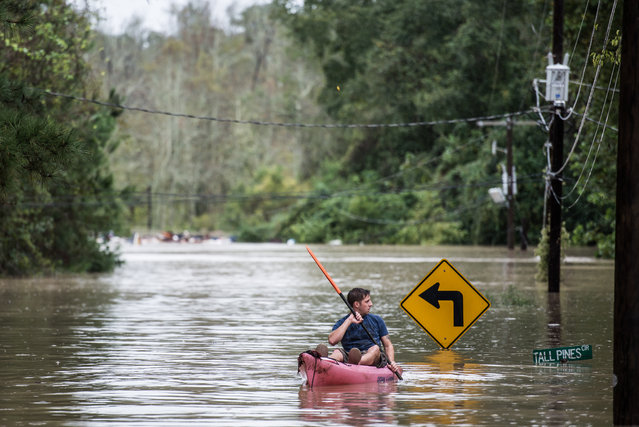 A man kayaks on Tall Pines Circle October 4, 2015 in Columbia, South Carolina. South Carolina experienced a record rainfall, with at least 11.5 inches falling October 3. (Photo by Sean Rayford/Getty Images)