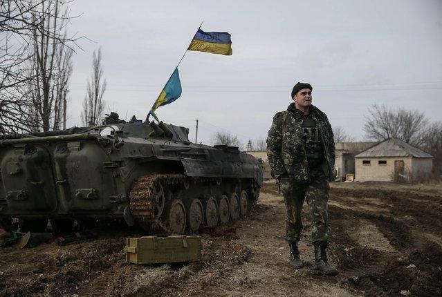 A Ukrainian serviceman is pictured at his position near Debaltseve, eastern Ukraine, February 8, 2015. (Photo by Gleb Garanich/Reuters)