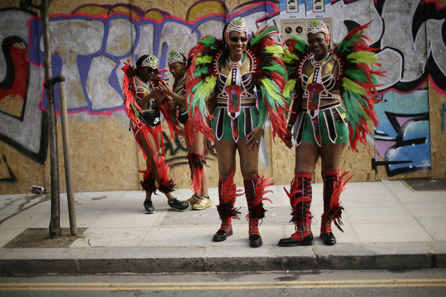 Costumed revellers ahead of the parade during the Notting Hill Carnival in London, Monday, August 27, 2018. (Photo by Tim Ireland/AP Photo)