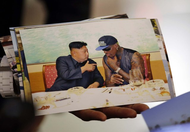 Former basketball star Dennis Rodman shows a picture which he took with North Korean leader Kim Jong-un as he arrives at Beijing Capital International Airport, on September 7, 2013. Kim again met Rodman during his second visit to North Korea this year, North Korea's state news agency said on Saturday, but made no mention on whether the two discussed the fate of a jailed American missionary. (Photo by Kim Kyung-Hoon/Reuters)