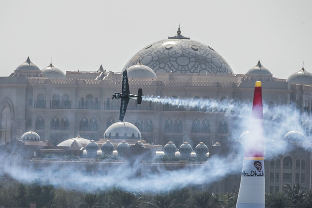In this photo provided by Naim Chidiac via Global-Newsroom, Pete McLeod of Canada performs during the qualifying of the first stage of the Red Bull Air Race World Championship in Abu Dhabi, United Arab Emirates, Friday, February 13, 2015. (Photo by Naim Chidiac/AP Photo/Global-Newsroom)