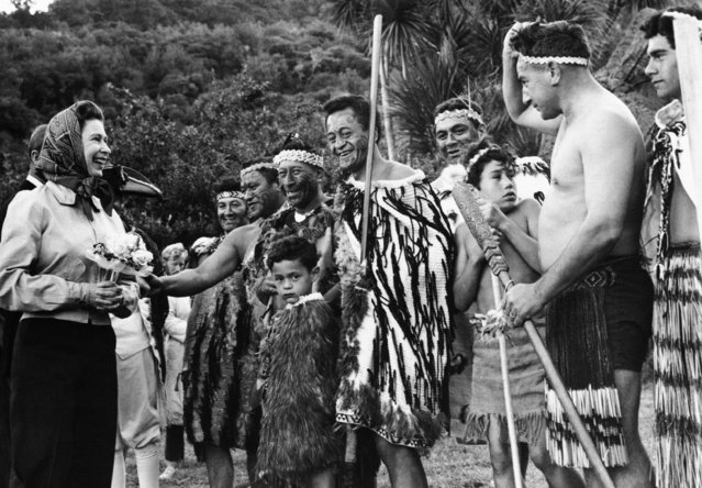 Maoris of the northern part of the South Island reverted to traditional costume to welcome Queen Elizabeth II when she visited Ship Cove, Queen Charlotte Sound, on Sunday, March 15, 1970. Ship Cove was Captain Cook's favourite anchorage in New Zealand waters and the Royal occasion saw an enactment of a landing by Cook and an exchange between him and Maoris of the area. (Photo by AP Photo)