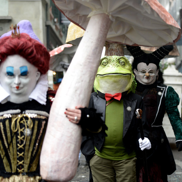 Masked revellers parade through the streets during the carnival in Lucerne, Switzerland, Monday, February 16, 2015. (Photo by Urs Flueeler/AP Photo/Keyston)