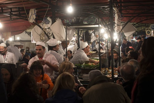 People eat at food stands in Djemaa El Fna square in Marrakesh December 8, 2014. (Photo by Youssef Boudlal/Reuters)