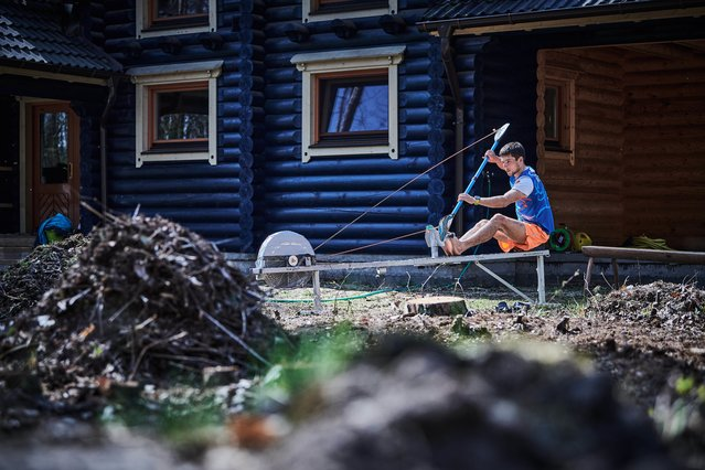 Sports Story Second Prize. Canoeist Jiri Prskavec trains in front of his house during a coronavirus state of emergency in the Czech Republic. (Photo by Barbora Reichová/Istanbul Photo Awards 2021)