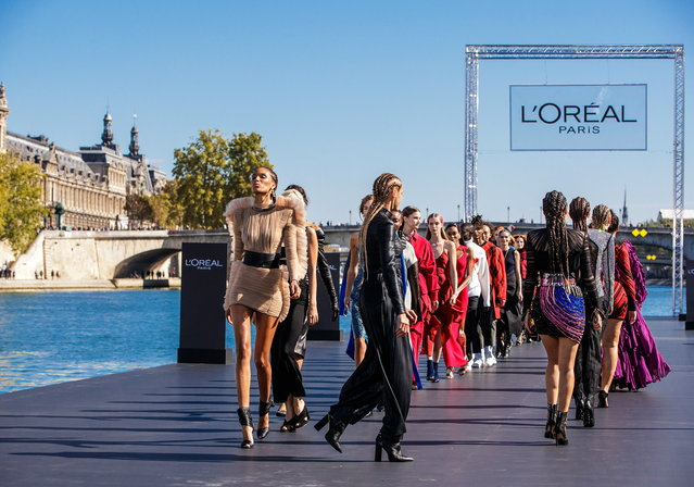 Models present creations on the catwalk as part of a fashion show organized by cosmetics company L'Oreal on the Seine, during the Paris Fashion Week, in Paris, France, 30 September 2018. The presentation of the Women's collections runs from 24 September to 02 October. (Photo by Christophe Petit Tesson/EPA/EFE)