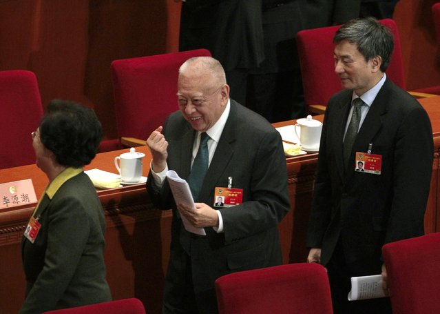 Former Hong Kong chief executive Tung Chee-hwa (C) laughs after the opening session of Chinese People's Political Consultative Conference (CPPCC) at the Great Hall of the People in Beijing, March 3, 2015. REUTERS/Barry Huang