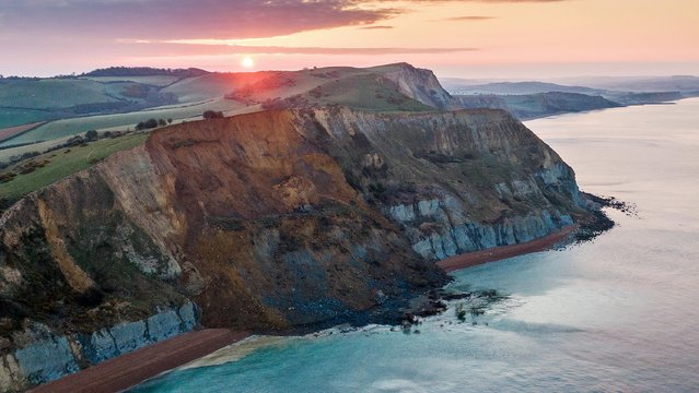 An aerial view of a cliff fall on April 14, 2021 in Seatown, United Kingdom. The 4,000-ton rockfall at Seatown has blocked off the beach between Seatown and Eype Beach, part of Britain's historic Jurassic Coast. The cliff fall is thought to be the biggest in 60 years. Dorset Council has warned that further falls are expected urging residents to stay clear of the area. (Photo by Finnbarr Webster/Getty Images)
