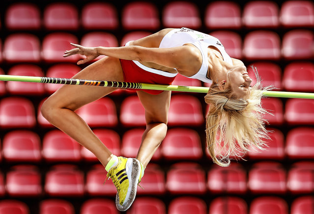 Sports Finalist – Ian MacNicol. Michalina Kwasniewska of Poland competes in the Women's high jump during day one of The European Athletics U23 Championships 2013  on July 11, 2013 in Tampere, Finland. (Photo by Ian MacNicol/Agence France-Presse)