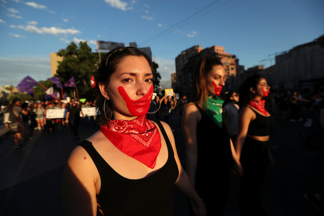 Demonstrators attend a march demanding an end to sexism and gender violence in Santiago, Chile on November 23, 2018. (Photo by Ivan Alvarado/Reuters)