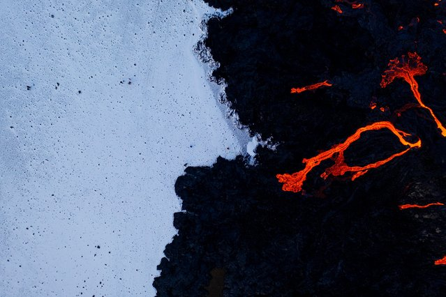 Lava oozes from a new fissure near Fagradalsfjall, Reykjanes Peninsula, Iceland on April 9, 2021. (Photo by Cat Gundry-Beck/Reuters)