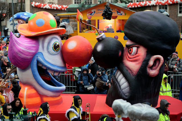 DA carnival float featuring a clown facing an Islamic fighter stands on display near city hall on February 8, 2016 in Duesseldorf, Germany. Today's Rose Monday parade, the highlight of western Germany's carnival season, has been cancelled due to weather predictions that include high winds.  (Photo by Sascha Steinbach/Getty Images)